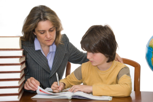 Mother helping her child with the homeworks